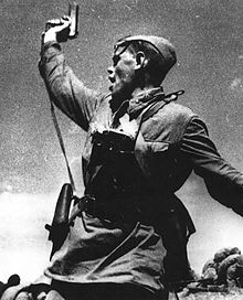 Soviet junior political officer armed with a Tokarev TT-33 Service Pistol urges Russian troops forward against German positions during World War II. The picture is allegedly of political officer Alexey Gordeevich Yeremenko, who is said to have been killed within minutes of this photograph being taken.